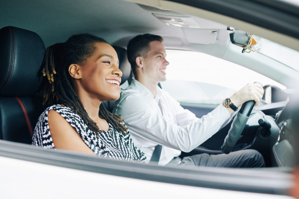 Multiethnic couple driving